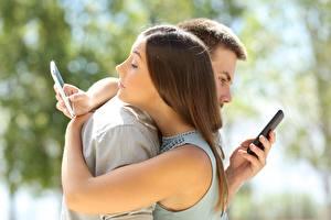 Картинки Обнимаются Две Размытый фон Подросток Смартфон social networks Девушки