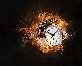 Фотографии Будильник Циферблат Огонь Часы На черном фоне