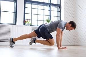 Фотография Фитнес Мужчины Физическое упражнение Шорт Футболка спортивная