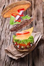 Картинки Гамбургер Котлеты Сыры Овощи Доски