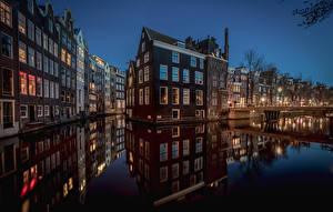 Фото Нидерланды Амстердам Дома Водный канал Ночные Города