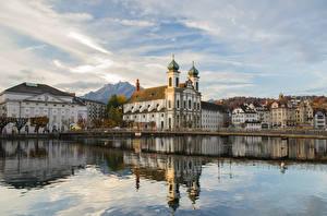 Фотографии Швейцария Церковь Вода Реки Отражении Luzern, Jesuitenkirche город