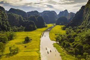 Фотография Вьетнам Речка Горы Поля Лодки NGO-Dong River, province Ninh Binh Природа