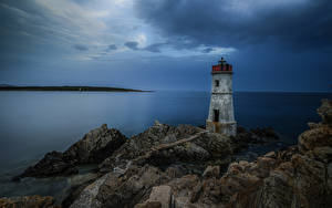 Картинки Италия Побережье Маяки Море Скале Sardinia Природа