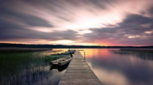 Картинка Швеция Рассветы и закаты Пристань Лодки Озеро Sparsör, Västra Götaland Природа
