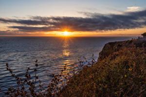 Фотографии США Рассветы и закаты Калифорния Залив Скалы Солнце Природа