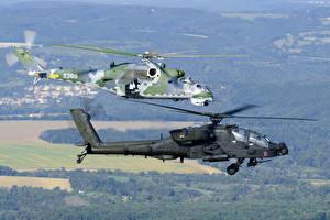 Обои для рабочего стола Вертолеты AH-64 Apache Вдвоем Летят Американские Российские Mi-24 Авиация