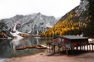 Картинка Горы Осенние Лес Пристань Лодки Италия Dolomite Alps, Lake Bries, South Tyrol Природа