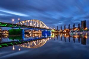 Картинки Голландия Здания Река Мосты В ночи Уличные фонари Malburgen Oost Provincie Gelderland Города