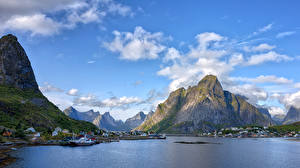 Обои Норвегия Лофотенские острова Горы Небо Облака Утес Reine Природа