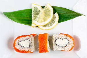 Фотография Суши Лимоны Рыба Трое 3 Листья Пища