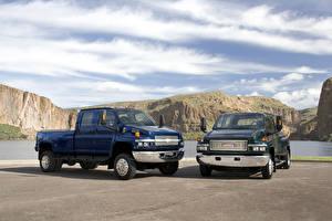 Обои для рабочего стола Chevrolet GMC Вдвоем Пикап кузов TopKick C4500, Kodiak C4500 Автомобили