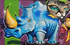 Фото Граффити Носороги Кошка Стене Рога Животные