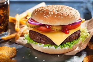 Фотографии Гамбургер Сыры Котлеты Быстрое питание Крупным планом Еда