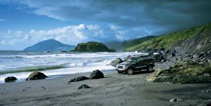 Картинки Джип Побережье Камень Горы SUV Черных Металлик Liberty Limited, 2004-2007 авто Природа