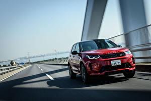 Фото Land Rover Дороги Движение Внедорожник Красный Металлик Discovery Sport D180 SE R-Dynamic, JP-spec, L550, 2020 машины