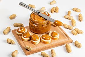 Обои Орехи Бутерброды Нож Белый фон Разделочная доска Банка Еда картинки