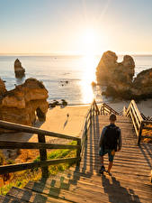 Фото Море Рассвет и закат Португалия Лестницы Утес Пляжа Camilo Beach