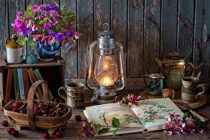 Фотографии Натюрморт Букеты Керосиновая лампа Вишня Стене Книга Лепестков Ваза Кружки Продукты питания