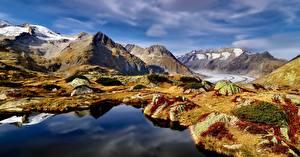 Обои для рабочего стола Швейцария Горы Озеро Камень Облачно Альпы Скале Aletsch Glacier Природа