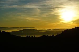 Фотография Швейцария Рассветы и закаты Небо Холм Туман Силуэты Basel-Landschaft Природа