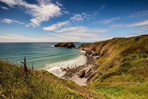 Фото Великобритания Берег Море Камни Небо Уэльс Облако Природа