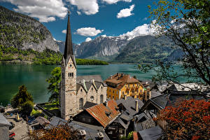 Фото Австрия Халльштатт Горы Озеро Альпы Башня Lake Hallstatt город