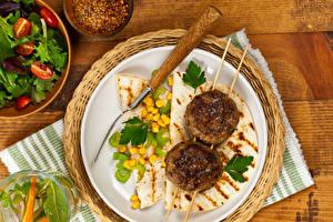 Фото Котлета Блины Овощи Доски Тарелке Вилка столовая Зерна Пища
