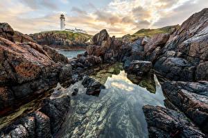 Картинка Ирландия Берег Камень Маяк Утес Fanad Lighthouse, Donegal Природа