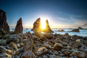 Фото Ирландия Побережье Камни Рассвет и закат Скалы Солнца Crohy Head Sea Arch Природа