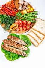 Фотографии Мясные продукты Хлеб Овощи Укроп Перец овощной Томаты Белый фон Разделочная доска Kebab Продукты питания