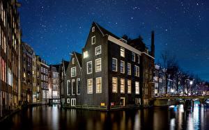 Фотографии Голландия Амстердам Здания Небо Звезды В ночи Водный канал город
