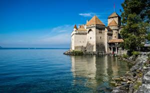Фотографии Швейцария Замок Озеро Небо Башни Chillon Castle, Lake Geneva Природа