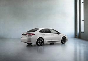 Обои Toyota Сбоку Белый Металлик Corolla Hybrid Sedan GR Sport, 2020 машина