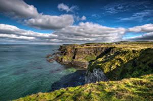 Фото Великобритания Побережье Небо Утес Облачно Antrim, Northern Ireland Природа
