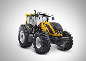 Фотографии Трактор Желтый Сером фоне Valtra BH