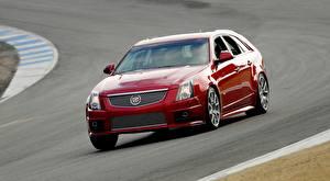 Фотография Cadillac Красные Металлик Движение Универсал CTS-V, Sport Wagon Автомобили
