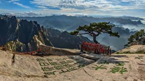 Картинка Китай Гора Иероглифы Облака Деревья Mount Hua Природа