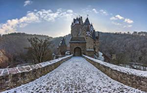 Картинка Германия Горы Замок Мост Снег Каменные Castle Eltz Природа