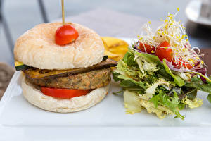 Картинки Гамбургер Булочки Котлеты Овощи Помидоры Пища