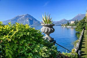 Картинка Италия Гора Озеро Альп Цветочный горшок Lago di Como, Varenna Природа