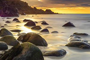 Картинки Норвегия Рассветы и закаты Камни Берег Природа