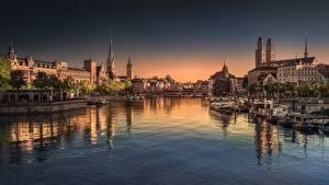 Обои Реки Мост Речные суда Швейцария Цюрих Вечер Limmat river город
