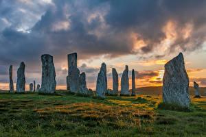 Фотография Шотландия Камни Рассветы и закаты Облака Траве Callanish Stones Природа