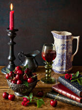 Фотографии Натюрморт Свечи Вишня Вино Кувшины Книга Бокал Еда