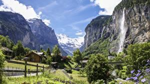Картинка Водопады Швейцария Горы Деревня Скале Альпы Canton Bern, Staubbach Waterfall, Lauterbrunnen Природа