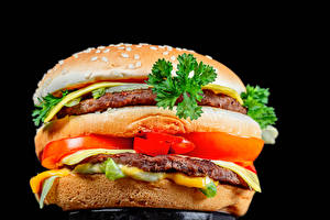 Обои Гамбургер Булочки Котлеты Овощи Черный фон Еда
