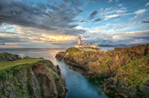 Фотографии Ирландия Побережье Маяки Небо Скалы Облака Fanad Head Lighthouse Природа