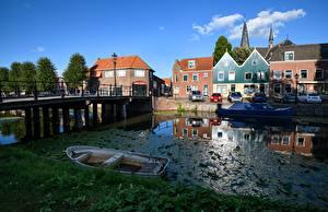 Фотографии Нидерланды Здания Лодки Мосты Водный канал Monnickendam