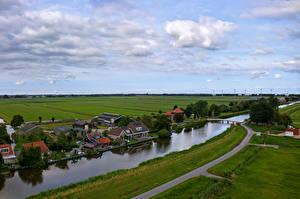 Фото Нидерланды Дома Речка Мосты Пристань Oudendijk город